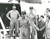 The crew of the Apollo 13 mission step aboard the U.S.S. Iwo Jima, prime recovery ship for the mission, following splashdown and recovery operations in the South Pacific. Exiting the helicopter, which made the pick-up some four miles from the Iwo Jima are (from left) astronauts Fred. W. Haise, Jr., lunar module pilot; James A. Lovell Jr., commander; and John L. Swigert Jr., command module pilot. The Apollo 13 spacecraft splashed down at 12:07:44 pm CST on April 17, 1970..Credit: NASA via CNP