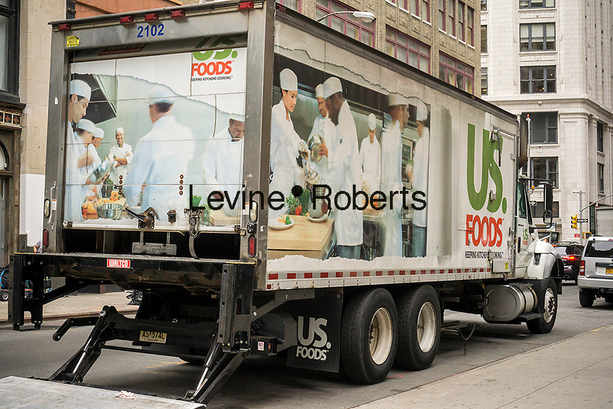 A US Foods delivery truck parked in the Flatiron neighborhood of New York on Thursday, July 2, 2015. Sysco Corp. has scrapped plans to merge with US Foods after a federal judge put the kibosh on the deal. Sysco is the largest restaurant food distribution company in the U.S. while US Foods is its biggest rival. The court felt that a merge would concentrate the industry and harm competition. (© Richard B. Levine)
