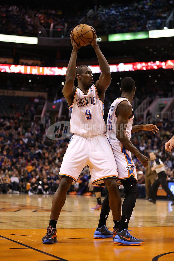 Feb. 10, 2013; Phoenix, AZ, USA: Oklahoma City Thunder power forward Serge Ibaka against the Phoenix Suns at the US Airways Center. Mandatory Credit: Mark J. Rebilas-