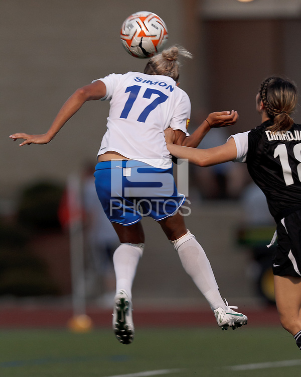Under pressures, Boston Breakers forward Kyah Simon (17) heads ball for third of three goal hat trick. In a Women's Premier Soccer League Elite (WPSL) match, the Boston Breakers defeated New England Mutiny, 4-2, at Dilboy Stadium on June 20, 2012.
