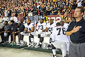 "Oakland Raiders players including offensive tackle Vadal Alexander (74), offensive tackle Marshall Newhouse (73), offensive guard Gabe Jackson (66), and Oakland Raiders offensive guard Jon Feliciano (76) sit on the bench and stare straight ahead as the national anthem is sung prior to the game against the Washington Redskins at FedEx Field in Landover, Maryland on Sunday, September 24, 2017. The Raiders chose to demonstrate prior to their nationally televised contest following tweets earlier in the day from United States President Donald J. Trump urging owners to ""fire or suspend"" players who participated in the protests by not standing for the anthem.<br /> Credit: Ron Sachs / CNP"
