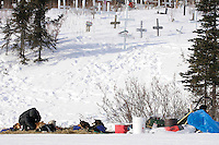 Heather Siirtola works with her team next to the cemetary in Koyuk on Friday