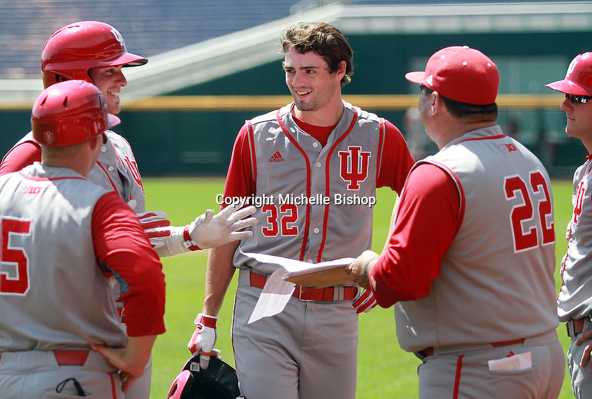 The Hoosiers relax for a moment during a Nebraska pitching change. Indiana's 6-2 win eliminated Nebraska from the Big Ten Tournament at TD Ameritrade Park in Omaha, Neb. on May 26, 2016. (Photo by Michelle Bishop)