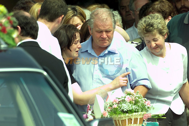 Marie Curtis Left being held by her family as her son remains are put in the back of the herse before the long walk to the grave yard...Picture Fran Caffrey Newsfile.