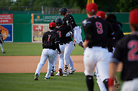Batavia Muckdogs Albert Guaimaro (13) is mobbed by teammates after hitting a walk off single during a NY-Penn League game against the Auburn Doubledays on June 19, 2019 at Dwyer Stadium in Batavia, New York.  Batavia defeated Auburn 5-4 in eleven innings in the completion of a game originally started on June 15th that was postponed due to inclement weather.  (Mike Janes/Four Seam Images)
