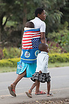 Woman With two Children with American Flag Towel Wrapped Around Her