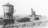 D&amp;RGW Gunnison yards with the water tank, coaling tower and roundhouse shown.  Ties are stacked in the foreground.<br /> D&amp;RGW  Gunnison, CO