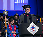 Scott Kelley, associate professor of religious studies and assistant vice president for Vincentian scholarship, offers an invocation Sunday, June 11, 2017, during the DePaul University College of Science and Health and College of Liberal Arts and Social Sciences commencement ceremony at the Allstate Arena in Rosemont, IL. (DePaul University/Jamie Moncrief)