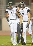 Inglewood, CA 10/09/14 - Jason Burr (Peninsula #7) and Alex Rosemond (Peninsula #11) in action during the Palos Verdes Peninsula vs Morningside CIF Varsity football game at Coleman Field in Inglewood.  Peninsula defeated Morningside 24-13.