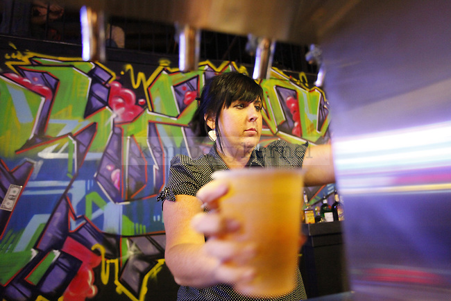 Maggie Mchugh serves up drinks on Sept. 4 at the grand reopening of Buster's on Manchester Street. Photo by Zach Brake | Staff