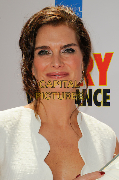 "BROOKE SHIELDS.The Los Angeles premiere of ""Furry Vengeance"" at Mann Bruin Theatre in Westwood, California, USA..April 18th, 2010 .headshot portrait hair up earrings silver white scallop edge edged wavy trim  .CAP/ROT.©Lee Roth/Capital Pictures"