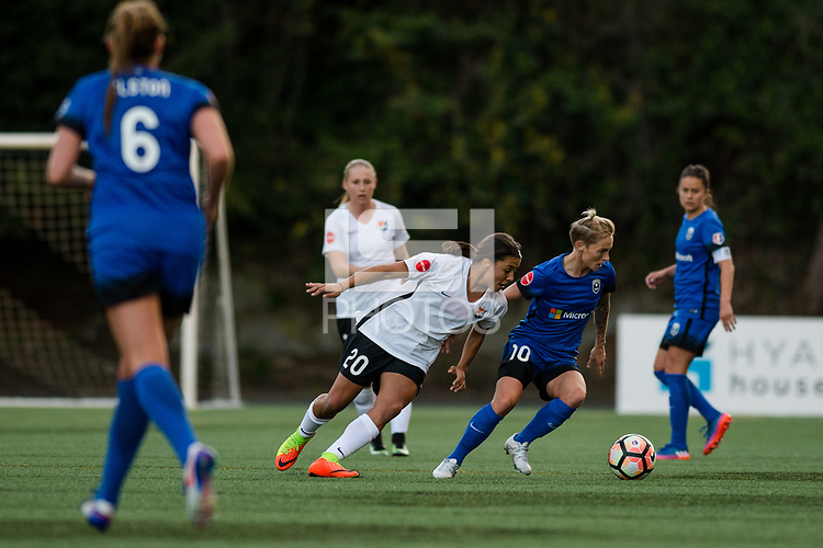 Seattle, WA - April 15th, 2017: Jess Fishlock and Samantha Kerr during a regular season National Women's Soccer League (NWSL) match between the Seattle Reign FC and Sky Blue FC at Memorial Stadium.