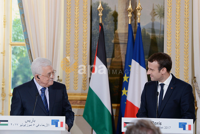 French President Emmanuel Macron and Palestinian President Mahmoud Abbas, hold a joint press conference following their meeting at the Elysee Palace in Paris, on July 5, 2017. Photo by Thaer Ganaim