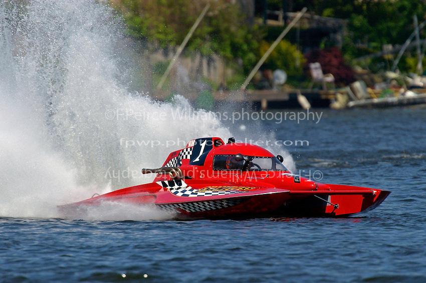 "George Kennedy, Jr., NM-1 ""Shameless"", National Mod class hydroplane..Lake Hopatcong, NJ USA 17 May, 2003.©F. Peirce Williams 2003..F. Peirce Williams .photography.P.O.Box 455 Eaton, OH 45320.p: 317.358.7326  e: fpwp@mac.com."