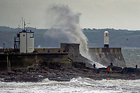 2018 09 20 Waves hit Porthcawl lighthouse in Bridgend during Storm Bronagh, Wales, UK.