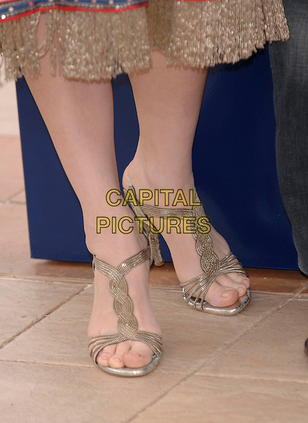 """CATE BLANCHETT'S SHOES.""""Babel""""  photocall.59th International Cannes Film Festival, France.23rd May 2006.Ref: PL.detail shoes feet sandals silver metallic.www.capitalpictures.com.sales@capitalpictures.com.©Phil Loftus/Capital Pictures"""