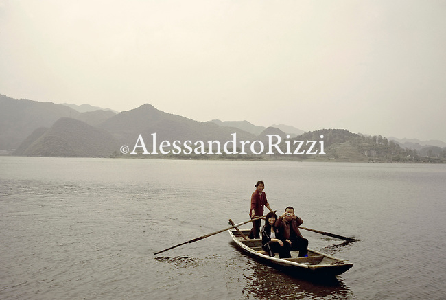 People standing on a boat on the river in Guiyang