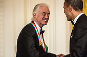 United States President Barack Obama shakes hands with Jimmy Page of the band Led Zeppelin after giving remarks at the Kennedy Center Honors reception at the White House on December 2, 2012 in Washington, DC. The Kennedy Center Honors recognized seven individuals - Buddy Guy, Dustin Hoffman, David Letterman, Natalia Makarova, John Paul Jones, Jimmy Page, and Robert Plant - for their lifetime contributions to American culture through the performing arts. .Credit: Brendan Hoffman / Pool via CNP