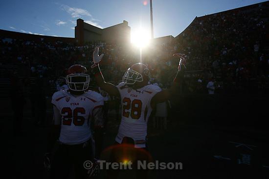 Trent Nelson     The Salt Lake Tribune.Ryan Lacy (26) Reggie Topps (28), pre game, as Utah faces Arizona, college football at Arizona Stadium in Tucson, Arizona, Saturday, November 5, 2011.