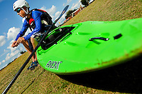 Young outdoor enthusiasts learn the art of whitewater kayaking during a summer camp session at the US National Whitewater Center (USNWC) in Charlotte NC. The USNWC is home to one of the world's largest manmade recirculating whitewater courses. Youth in this photo is model released.