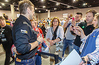 Martin Buser poses for a photo with race fans at the 2016 Iditarod musher position drawing banquet at the Dena'ina convention center in Anchorage, Alaska on Thursday March 3, 2016  <br /> <br /> &copy; Jeff Schultz/SchultzPhoto.com ALL RIGHTS RESERVED<br /> DO NOT REPRODUCE WITHOUT PERMISSION