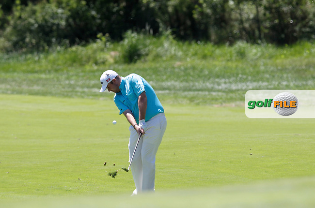 Shane Lowry (IRL) plays his 3rd shot on the 7th hole during Thursday's Round 1 of the 2014 Open de Espana held at the PGA Catalunya Resort, Girona, Spain. Wednesday 15th May 2014.<br /> Picture: Eoin Clarke www.golffile.ie