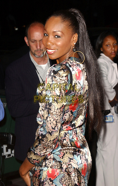 "VENUS WILLIAMS.The Twentieth Century Fox Los Angeles Premiere of ""In Her Shoes"" held at The Academy of Motion Pictures Arts & Sciences in Beverly Hills, California.  .September 28th, 2005.Ref: DVS.half length pattern print silk satin dress looking over shoulder.www.capitalpictures.com.sales@capitalpictures.com.Supplied By Capital PIctures"