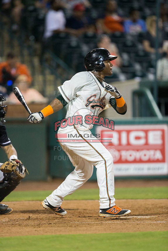 Isael Soto (15) of the Greensboro Grasshoppers follows through on his swing against the Kannapolis Intimidators at NewBridge Bank Park on July 7, 2016 in Greensboro, North Carolina.  The Dash defeated the Pelicans 13-9.  (Brian Westerholt/Four Seam Images)