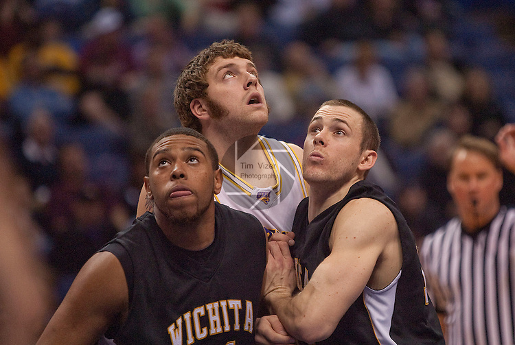 March 7,  2010           From left:  Wichita State forward/center J.T. Durley (31), Northern Iowa forward Lucas O'Rear (32), and Wichita State guard/forward Graham Hatch (14) wait for the ball to rebound in the second half.  The University of Northern Iowa defeated Wichita State 67-52 on Sunday March 7, 2010 in the championship game of the Missouri Valley Conference Tournament at the Scottrade Center in downtown St. Louis.   They automatically earn a berth in the NCAA Tournament.