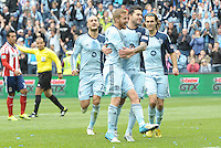 Sporting KC players celebrate Claudio Bieler's converted penalty kick..Sporting Kansas City defeated Chivas USA 4-0 at Sporting Park, Kansas City, Kansas.