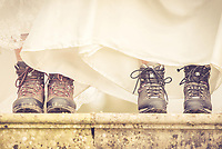 These brides have a passion for travelling and hiking, creating a quirky shot in their dresses with their boots on!