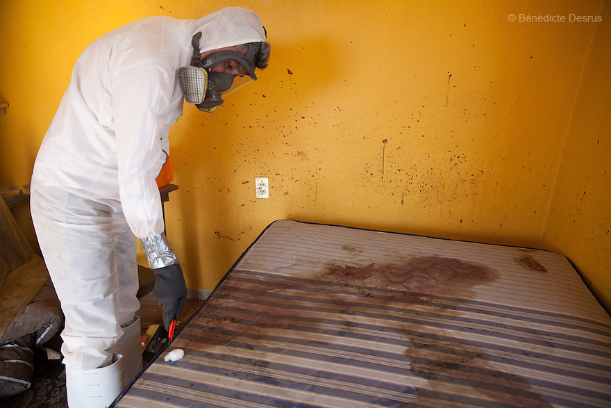 "Donovan carries out a forensic cleaning of the scene of an unsolved homicide in Cuernavaca, Morelos – one of Mexico's most dangerous cities on August 7, 2015. The 66-year-old victim was a retired economics lecturer from the local university, and was killed in January of this year. The cleanup took place eight months later. The victim's family has since moved away to avoid further trouble. They remarked that justice is slow in Mexico and expressed dissatisfaction with the police investigation, but appreciated Donovan's discretion and professionalism. Donovan Tavera, 43, is the director of ""Limpieza Forense México"", the country's first and so far the only government-accredited forensic cleaning company. Since 2000, Tavera, a self-taught forensic technician, and his family have offered services to clean up homicides, unattended death, suicides, the homes of compulsive hoarders and houses destroyed by fire or flooding. Despite rising violence that has left 70,000 people dead and 23,000 disappeared since 2006, Mexico has only one certified forensic cleaner. As a consequence, the biological hazards associated with crime scenes are going unchecked all around the country. Photo by Bénédicte Desrus"