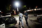 Sacramento Police Department Officer Jon Gresham walks a suspect to his patrol car after finding him in possession of methamphetamine during the graveyard shift on  October 26, 2012 in Sacramento, Calif. Budget cuts have decimated the Sacramento Police Department resulting in the elimination of many investigative units.
