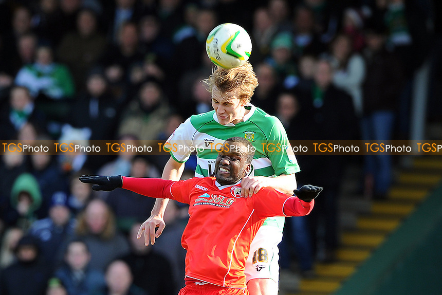 Dan Burn of Yeovil Town beats Craig Westcarr of Walsall in the air - Yeovil Town vs Walsall - NPower League One Football at Huish Park, Yeovil, Somerset - 29/03/13 - MANDATORY CREDIT: Denis Murphy/TGSPHOTO - Self billing applies where appropriate - 0845 094 6026 - contact@tgsphoto.co.uk - NO UNPAID USE.