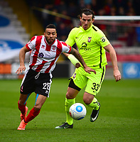 Lincoln City's Nathan Arnold vies for possession with York City's Sean Newton<br /> <br /> Photographer Andrew Vaughan/CameraSport<br /> <br /> Buildbase FA Trophy Semi Final Second Leg - Lincoln City v York City - Saturday 18th March 2017 - Sincil Bank - Lincoln<br />  <br /> World Copyright &copy; 2017 CameraSport. All rights reserved. 43 Linden Ave. Countesthorpe. Leicester. England. LE8 5PG - Tel: +44 (0) 116 277 4147 - admin@camerasport.com - www.camerasport.com