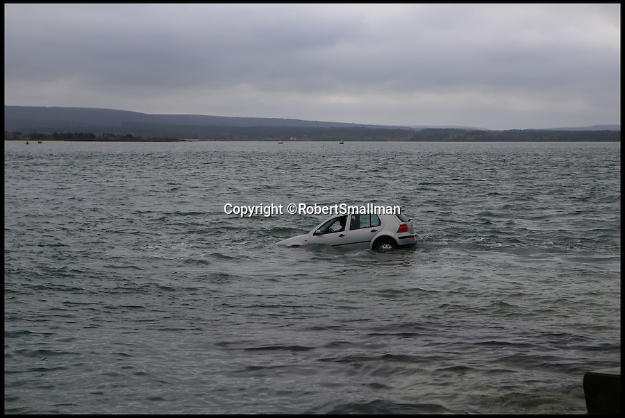 BNPS.co.uk (01202 558833)<br /> Pic: RobertSmallman/BNPS<br /> <br /> *Please use full byline*<br /> <br /> The car, and woman, just after it was driven into the water.<br /> <br /> An elderly woman has today been rescued from her sunken car after she 'deliberately' drove into a harbour in front of stunned day-trippers.The motorist, aged in her 70s, wound down both windows of her Volkswagen Golf before speeding down a ferry slipway and into the water.As the silver car was swept 100 yards out to sea by the fast tide the woman sat motionless in the flooded driver's seat, ignoring cries from witnesses on the quayside to get out.A brave crew member of a passing fishing boat then dived into the water and pulled the woman free just moments before her vehicle completely sank.