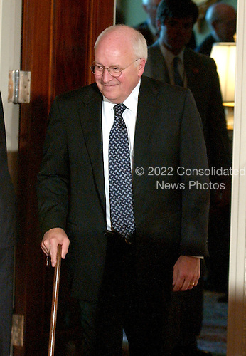 Washington, DC - September 29, 2005 -- Vice President Dick Cheney walks with a cane after his surgery to repair veins in both of his knees as he arrives for the ceremony where John Glover Roberts, Jr. was sworn-in as the 17th Chief Justice of the United States in the East Room of the White House in Washington, D.C. on September 29, 2005.  ..Credit: Ron Sachs / CNP