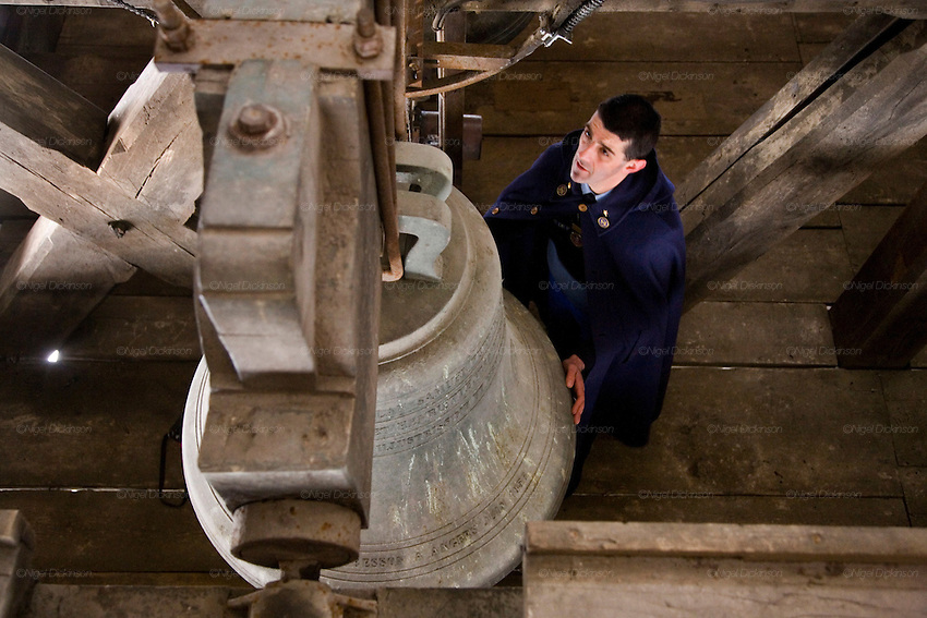 The modern day Quasimodo of Notre Dame Cathedral. Paris, France.  Stephane Urbain is the Chief Sacristain. Apart from his other duties, he is in charge of all aspects of the bells. There are at least four masses each day everyday of the year. The bells sound on the hour and half hour, and there are special melodies played at certain times, for festivals, celebrations and events. Stephane Urbain writes and calibrates the bells co-ordinated with a computer. the days of manual bell ringers and 'clochards' are in the past.///Stephaine Urbain, Head Sacristain of Notre Dame Cathedral, in the bell tower. with the bell 'Angelique Francoise'