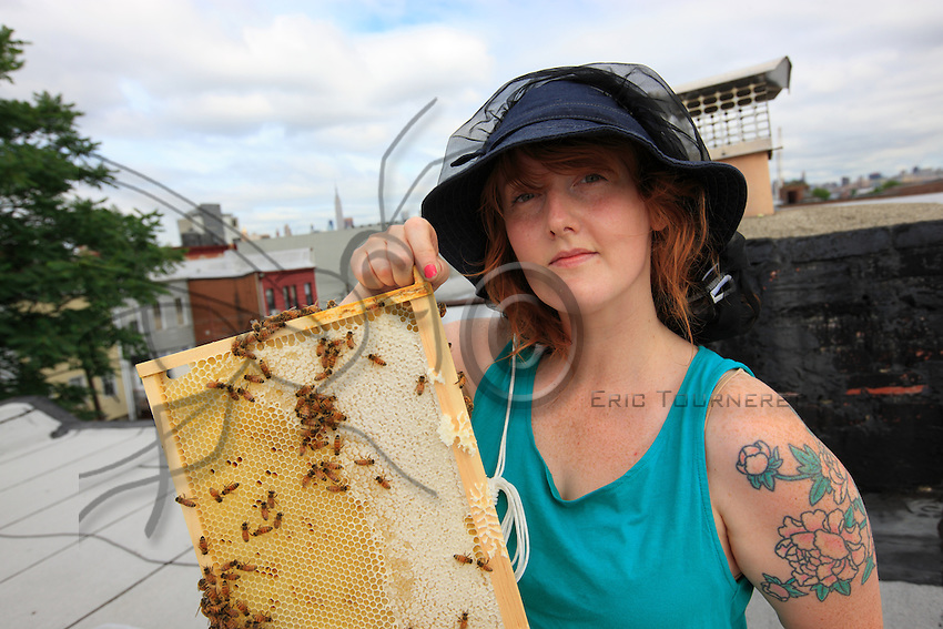 """Megan Paska, 29 years old, from Brooklyn. She started beekeeping in January.  """"I come from Baltimore in Maryland but my family is from the country and during my childhood we had a garden. For me, who came to New York recently, it is also a way of meeting people with different interests. I am fascinated. I open my hive every week, watching the bees is for me like meditation, a way to relax. I work for a company that makes children's clothing""""."""