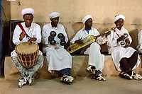 Merzouga, Morocco.  Gnaoua Musicians Playing Drum, Krakeb, and Gimbrie.