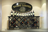 Bottles aging in the cellar. Chateau Malartic Lagraviere, Pessac Leognan, Graves, Bordeaux, France
