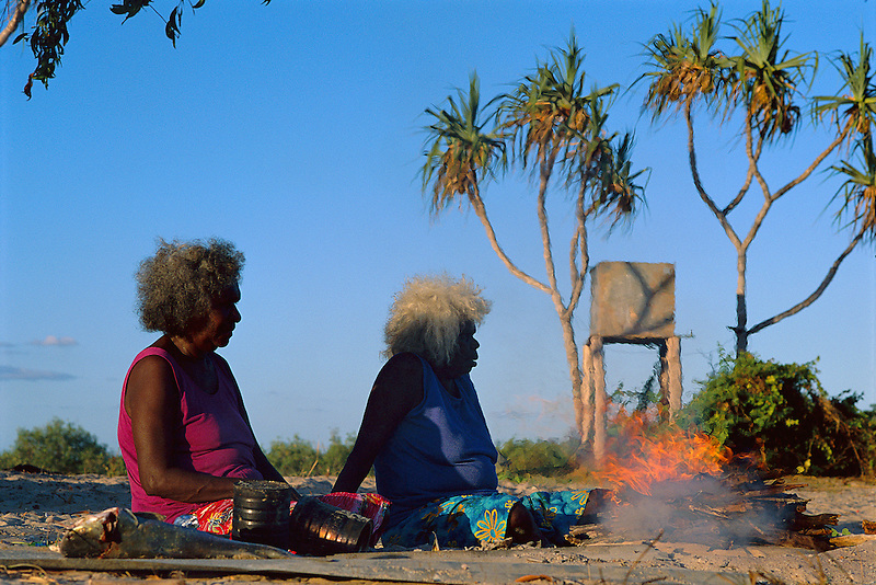 Suzi Yunkaporta and Peace Woolla preparing a meal on country, Aurukun, Cape York Peninsula.