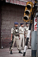 Indian paramilitary soldier and police stand guard at a check point in Lal Chow area, Srinagar, as India is celebrating the Independence day. The curfew was declared into the most conflictive areas across the city and districts into the Kashmir valley. Security has been beefed up by indian paramilitary forces (CRPF), army and police on streets and check points.