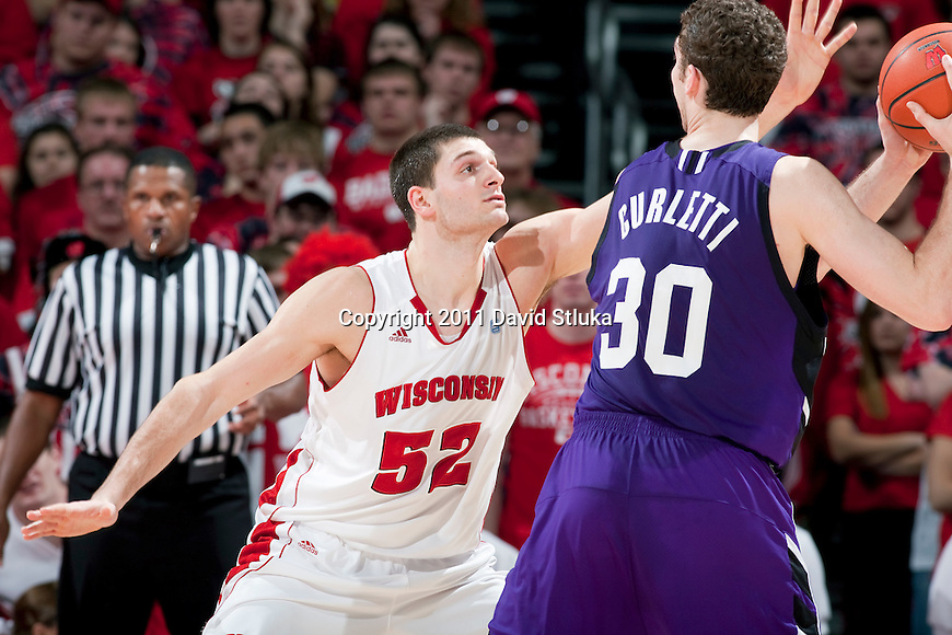 Wisconsin Badgers forward Keaton Nankivil (52) defends against Northwestern Wildcats forward Davide Curletti (30) during a Big Ten Conference NCAA men's college basketball game at the Kohl Center on February 27, 2011 in Madison, Wisconsin. Wisconsin won 78-63. (Photo by David Stluka)