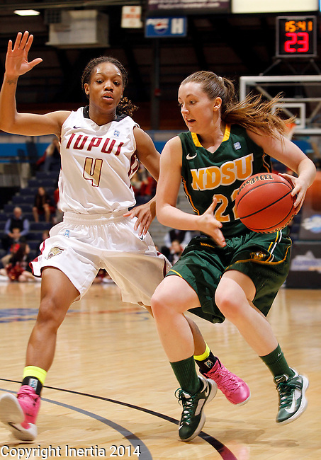 SIOUX FALLS, SD - MARCH 8:  Bree Whatman #22 from NDSU drives against Dee Dee Bellamy #4 from IUPUI in the second half of their quarterfinal game Saturday afternoon at the 2014 Summit League Championship in Sioux Falls, SD. (Photo by Dave Eggen/Inertia)