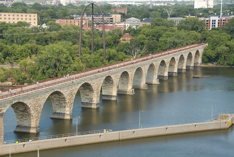 Minnesota, Twin Cities, Minneapolis-Saint Paul: Stone Arch Bridge crosses Mississippi at Minneapolis.  Former railroad bridge now used for recreation. .Photo mnqual254-75344..Photo copyright Lee Foster, www.fostertravel.com, 510-549-2202, lee@fostertravel.com.