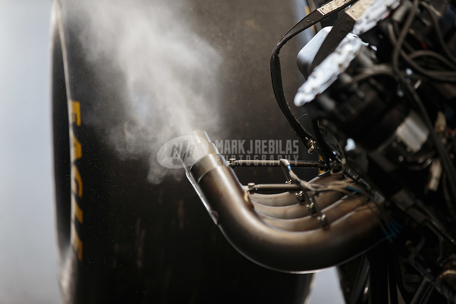 Feb 11, 2019; Pomona, CA, USA; Detailed view of exhaust fumes and smoke coming from the header pipes on the engine of the dragster of NHRA top fuel driver Mike Salinas during the Winternationals at Auto Club Raceway at Pomona. Mandatory Credit: Mark J. Rebilas-USA TODAY Sports