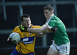 Conor Finucane of Clare  in action against Brian Fanning of Limerick during the Mc Nulty Cup U-21 final at The Gaelic Grounds. Photograph by John Kelly.