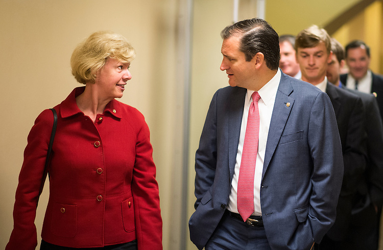 UNITED STATES - JULY 17: Sen. Tammy Baldwin, D-Wisc., and Sen. Ted Cruz, R-Texas, talk as they walk to the Senate subway in the Capitol on Wednesday, July 17, 2013. (Photo By Bill Clark/CQ Roll Call)