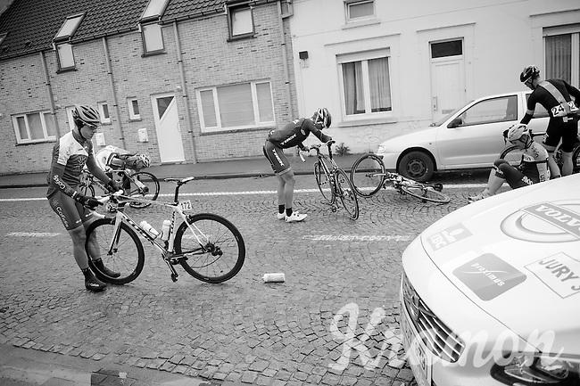 mid peloton crash leaves a few riders on the cobbles<br /> <br /> Dwars Door Vlaanderen 2014